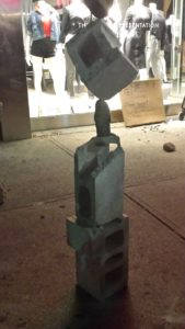 impromptu-rock-balancing-on-queen-street-during-nuit-blanche